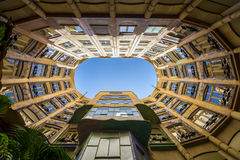 Barcelona, Spain. May 6, 2017: Casa Mila by Antoni Gaudi A view from the central courtyard look up at the sky above Stock Images