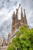 BARCELONA, SPAIN - MAY 14, 2018: Cathedral of La Sagrada Familia on a cloudy day. It is designed by architect Antonio Gaudi and is. Being build since 1882 stock photo