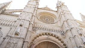 BARCELONA, SPAIN - May, 2018: Gothic Catholic Cathedral Facade Steeples. Stock. Barcelona Cathedral, Ghotic Quarter. Spain in a beautiful summer day, Spain stock video footage