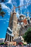 The Expiatory Temple of the Sagrada Familia. BARCELONA, SPAIN - MAY 13, 2017: Imposing view of the Sagrada Familia Temple from the street, with a beautiful blue Stock Images