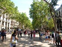 Barcelona, Spain - May 10 2014: People walking on La Rambla street stock photo