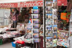 View of newsagent stall selling. Barcelona, Spain-May 27, 2013: View of newsagent stall selling newspapers, magazines and tourist souvenirs on the famous Las royalty free stock photo