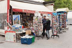View of newsagent stall selling. Barcelona, Spain-May 27, 2013: View of newsagent stall selling newspapers, magazines and tourist souvenirs on the famous Las stock images