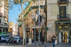 Pedestrians walking in front of Farmacia Dra Gallardo Sauret