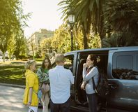Stylish tourists embarking tourist van before leaving the Parc d. Barcelona, Spain - Nov 12, 2017: stylish tourists embarking tourist van before leaving the Parc royalty free stock photos