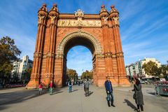 Morning at Arc de Triomf, Barcelona Spain. BARCELONA - SPAIN, NOVEMBER 20, 2015 : People and Arc de Triomf. A triumphal arch in Barcelona in Catalonia, Spain. It Royalty Free Stock Photography
