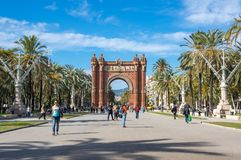 The Arc de Triomf. BARCELONA, SPAIN - OCTOBER 22, 2015: The Arc de Triomf  is a triumphal arch in the city of Barcelona in Catalonia, Spain. The arch is built in Royalty Free Stock Photos