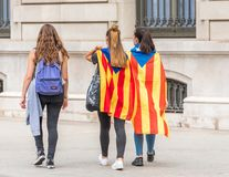 BARCELONA, SPAIN - OCTOBER 3, 2017: Demonstrators bearing catalan flags during protests for independence in Barcelona. Copy space for text Stock Photography