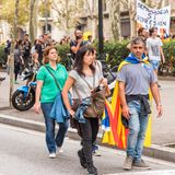 BARCELONA, SPAIN - OCTOBER 3, 2017: Demonstrators bearing catalan flags during protests for independence in Barcelona. Close-up. Stock Photo