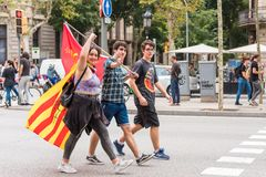 BARCELONA, SPAIN - OCTOBER 3, 2017: Demonstrators bearing catalan flags during protests for independence in Barcelona. Copy space Royalty Free Stock Image