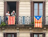 BARCELONA, SPAIN - OCTOBER 3, 2017: People on the balcony during a demonstration in Barcelona. Royalty Free Stock Images