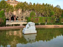 Barcelona, Spain - 15 October 2013 - Sculpture Despair on background of the Parliament of Catalonia stock photography