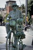 Transformation of man into monument or popular movie character. Barcelona, Spain - October 9, 2017: Trendy entertainment, transformation of man into monument or Royalty Free Stock Photography
