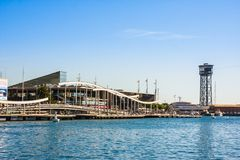 Barcelona, Spain - October 18, 2014: View of Barcelona port with Maremagnum commercial center and cable car tower at background. Barcelona, Spain - October 18 Stock Photos