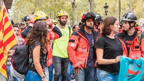BARCELONA, SPAIN - OCTOBER 3, 2017: Workers in helmets at a demonstration in Barcelona. Stock Photos
