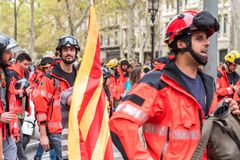 BARCELONA, SPAIN - OCTOBER 3, 2017: Workers in helmets at a demonstration in Barcelona. Close-up. Stock Photos