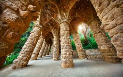 Barcelona, Spain. Park Guell. Antonio Gaudi Architecture. Barcelona, Spain. Park Guell. Antonio Gaudi Art Architecture. Stone pillars with archs at sunset among royalty free stock photography