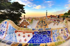 Barcelona, Spain: Park Guell. View of the city from Park Guell in Barcelona sunrise. Park Guell by architect Antoni Gaudi royalty free stock photos