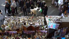 People buy antiques in the market. Sale of antiques on a flea market, top view