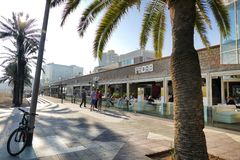 Barcelona Spain seafront perspective view of bar and restaurant terraces with tourists dining. Barcelona Spain circa November 2016 seafront perspective view of Royalty Free Stock Photo