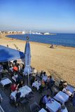 Barcelona Spain seafront perspective view of bar and restaurant terraces with tourists dining. Barcelona Spain circa November 2016 seafront perspective view of Stock Photography