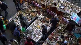 Man sells vintage badges, watches, paintings, jewelry at the flea market