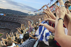 BARCELONA, SPAIN - SEPTEMBER 27, 2014: Barcelona vs Granada: Barcelona fans wave after a goal. Barcelona won 6-0. Stock Images