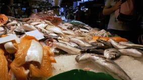 Counter with Seafood in La Boqueria Fish Market. Barcelona. Spain. BARCELONA, SPAIN, SEPTEMBER 22, 2017: Counter with Seafood in La Boqueria Fish Market stock video