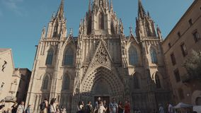 Barcelona, Spain - September 2018: Famous catholic Barcelona Cathedral in sunny day. Tilt up view on facade and square. Barcelona, Spain - September 2018: Famous stock footage