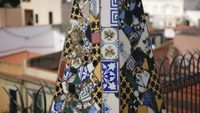 Fantastic shapes fo chimneys and central spire on roof of Guell Palace by Antoni Gaudi