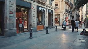 Barcelona, Spain - September 2018: Historical center of the city Gothic Quarter. Motorcyclists and passersby are moving. Barcelona, Spain - September 2018 stock video