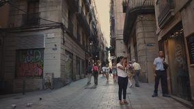 Barcelona, Spain - September 2018: Historical part of capital Gothic Quarter. Tourists and city dwellers are walking on. Barcelona, Spain - September 2018 stock video footage