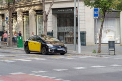 Barcelona, Spain - 25 September 2016: Hybrid taxi at a taxi stop in Barcelona. Yellow and black taxi car parked in Barcelona City. Yellow and black taxi car royalty free stock image