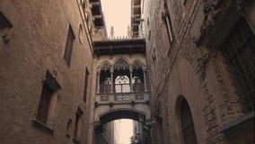 Barcelona, Spain - September 2018: Kisses bridge in Carrer del Bisbe, Bishop Street, in center of Gothic Quarter. Tilt. Barcelona, Spain - September 2018: Kisses stock footage