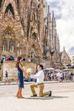 BARCELONA, SPAIN - SEPTEMBER 15, 2015: in love with a man confesses his love for the girl, kneeling in front stock photos