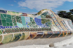 Barcelona, Spain - 24 September 2016: Park Guell mosaic seating at Nature Square Placa de la Natura. Mosaic seating area with multi-coloured tiles at at Nature Royalty Free Stock Photos