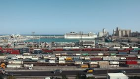 Barcelona, Spain September 2018: The Port of Barcelona. Panoramic view on railway parking and sea, car traffic. Barcelona, Spain September 2018: The Port of stock video footage
