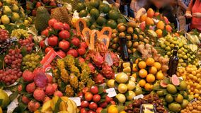 Showcase with Fresh Tropical Fruits and Vegetables in La Boqueria Food Market. Barcelona, Spain. BARCELONA, SPAIN, SEPTEMBER 22, 2017: Showcase with Fresh stock video footage