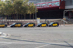Barcelona, Spain - 25 September 2016: Taxis parked at a stop in Barcelona City. Yellow and black taxi cars row in the Forum area stock photo