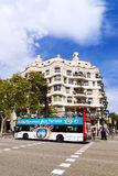 BARCELONA, SPAIN - SEPTEMBER 15: Tourist bus near La Pedrera Stock Image