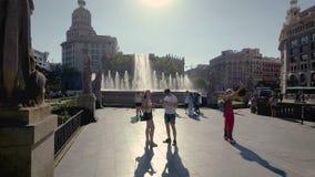 Barcelona, Spain - September 2017. Tourists taking photos next to a fountain in Placa de Catalunya. stock video