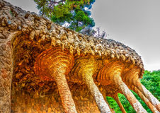 In Barcelona in Spain. Strange stone constructions in the famous park Guell at Barcelona in Spain. HDR processed Stock Photos