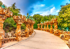 In Barcelona in Spain. Strange stone constructions in the famous park Guell at Barcelona in Spain. HDR processed Royalty Free Stock Image
