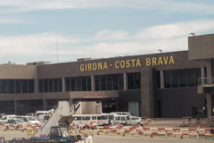 Barcelona, Spain terminal and sign view of Girona Costa Brava airport from inside airplane. Terminal and sign view from inside airplane of Girona Costa Brava Royalty Free Stock Images