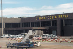 Barcelona, Spain terminal and sign view of Girona Costa Brava airport from inside airplane. Terminal and sign view from inside airplane of Girona Costa Brava Royalty Free Stock Photos