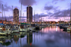 Barcelona, Spain. Twin skyscrapers towering over the marina in Port Olimpic (Olympic Harbor), Barcelona, Spain at sunset royalty free stock images