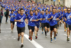 Barcelona street crowded of athletes running Royalty Free Stock Images