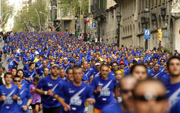 Barcelona street crowded of athletes running Stock Photography