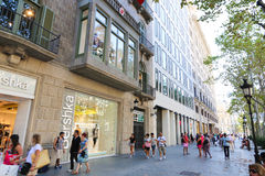 Barcelona streets. Tourists enjoy at Streets and buildings of Barcelona, Spain Royalty Free Stock Photo