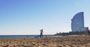 Barcelona sunny day beach kite training girl 4k spain. Spain barcelona sunny day beach kite training girl 4k stock video footage
